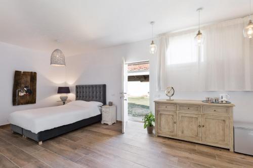 Cama o camas de una habitación en Masia Can Rovira - ESC1852