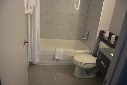 A bathroom at Super 8 by Wyndham Windsor/Dougall