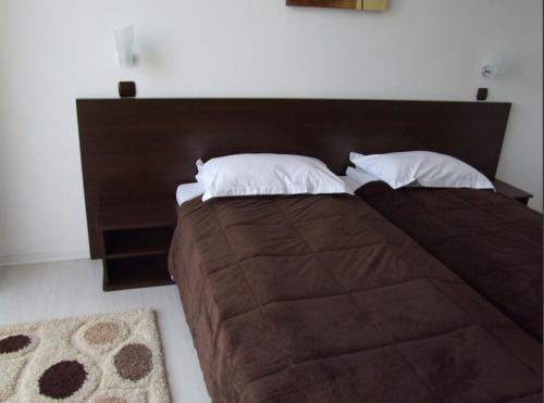 Un pat sau paturi într-o cameră la PLAISIR