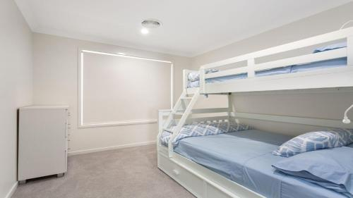 A bunk bed or bunk beds in a room at 28 Kentia