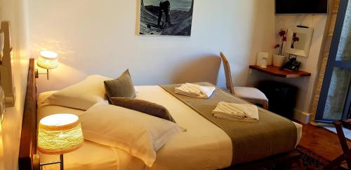 A bed or beds in a room at The Fabris - Luxury Inn
