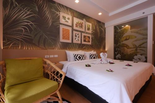 A bed or beds in a room at Panan Krabi Resort