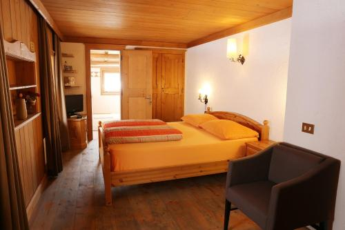 Postel nebo postele na pokoji v ubytování Baita Luleta