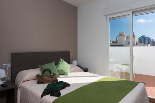 Cama o camas de una habitación en Hotel Roca-Mar