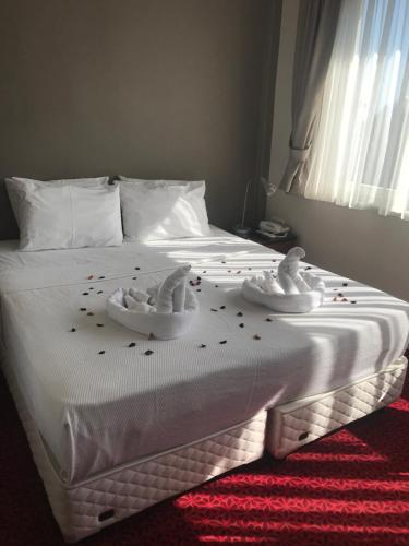 A bed or beds in a room at Hotel Sultanahmet