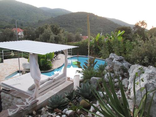A view of the pool at Holiday Homes Relax or nearby