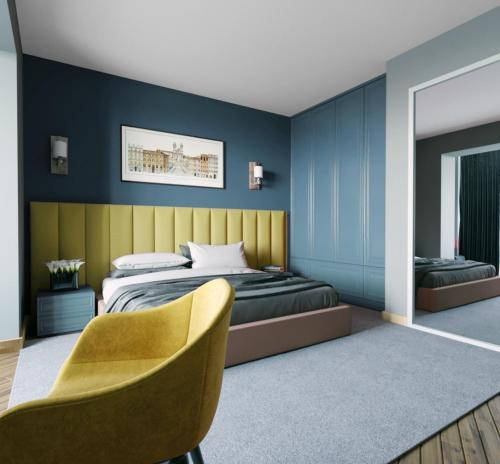 A bed or beds in a room at Centric Baku Boutique Hotel