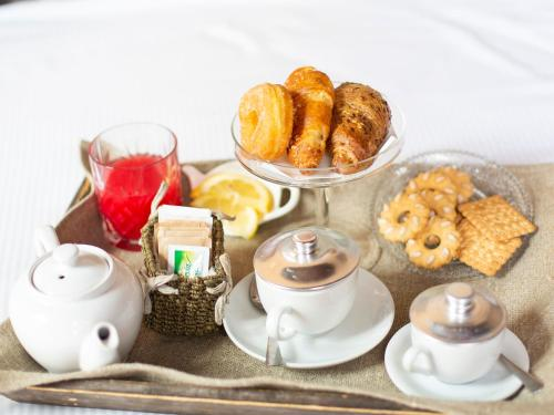 Breakfast options available to guests at Hotel Adriano