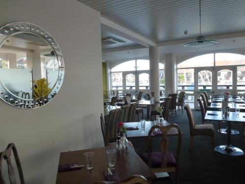 A restaurant or other place to eat at Boathouse Hotel