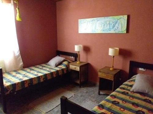 Una cama o camas en una habitación de Los Abuelos Departamentos