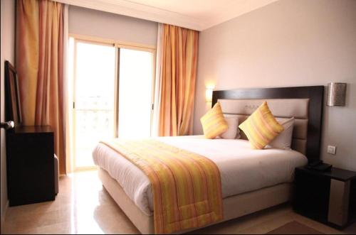 A bed or beds in a room at luxury apartment