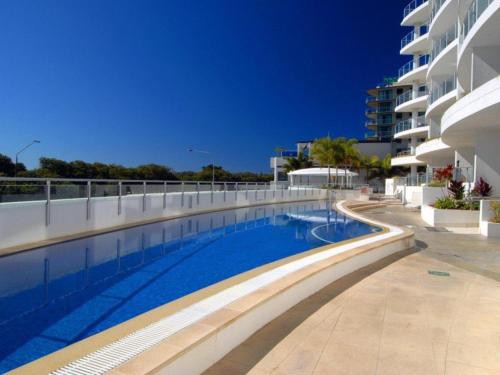 The swimming pool at or near Sebel 808 by G1 Holidays