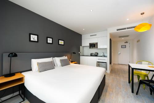 A bed or beds in a room at Staycity Aparthotels London Heathrow
