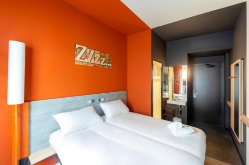 Cama o camas de una habitación en Ibis Budget Bilbao City