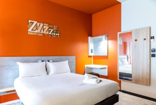 A bed or beds in a room at Ibis Budget Bilbao City