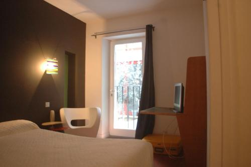 A bed or beds in a room at Hotel Burrhus