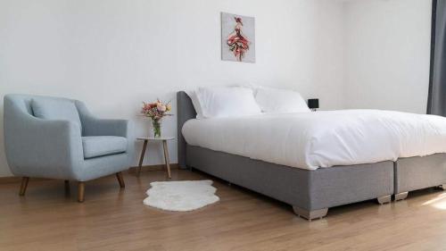 Un ou plusieurs lits dans un hébergement de l'établissement Hôtel Restaurant La Croix Verte