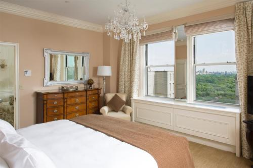 A bed or beds in a room at The Sherry Netherland