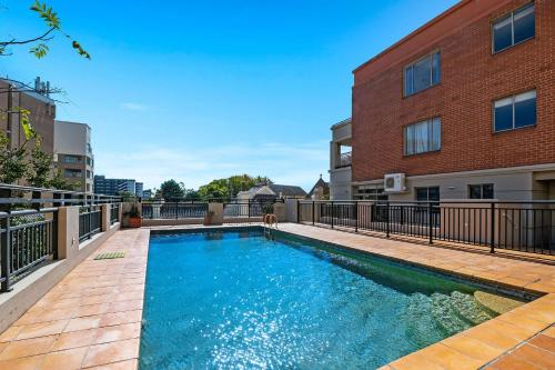The swimming pool at or near Quality Apartments Camperdown