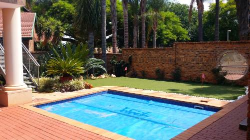 The swimming pool at or close to The Club House Guest House