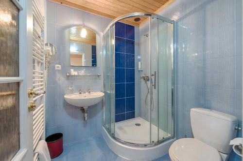 Koupelna v ubytování Hotel Zlatý Orel