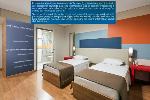 A bed or beds in a room at TRYP - Transit Hotel São Paulo Airport - Terminal 3