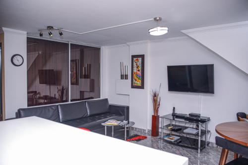 A television and/or entertainment center at Apartment Carrera 301