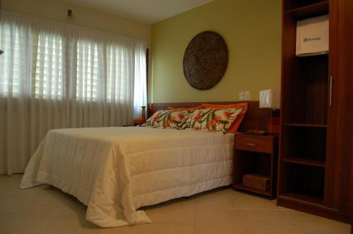 Cama ou camas em um quarto em Pipa Park