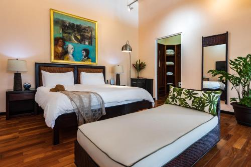 A bed or beds in a room at Gaia Hotel & Reserve- Adults Only