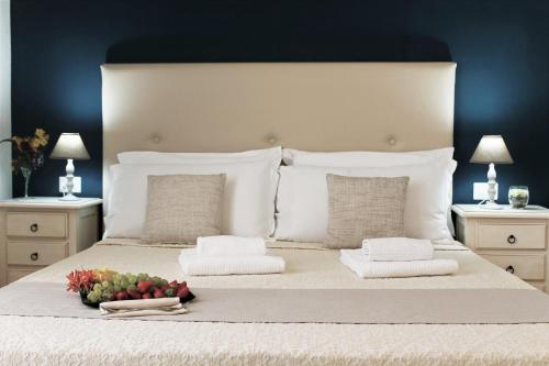 Cama ou camas em um quarto em AHR Residence Leonis La Maddalena