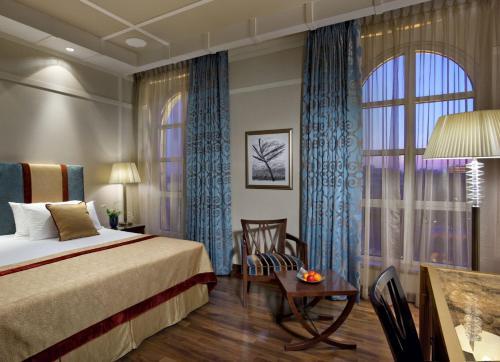 Un ou plusieurs lits dans un hébergement de l'établissement King David Hotel Jerusalem