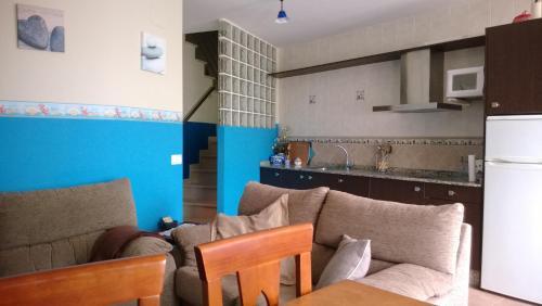 Zona de estar de Apartamentos Turisticos As Cetareas