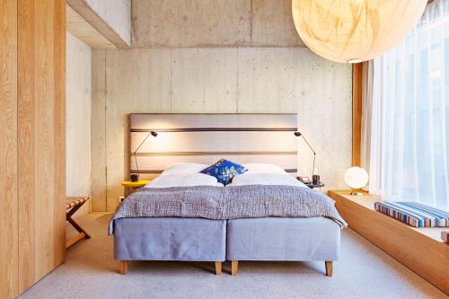 A bed or beds in a room at Nomad Design & Lifestyle Hotel