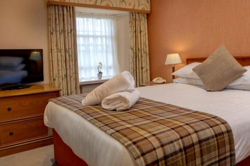 A bed or beds in a room at The Winnock Hotel, Sure Hotel Collection by Best Western