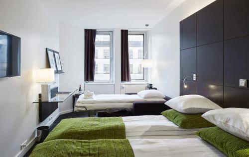 En eller flere senge i et værelse på The Square