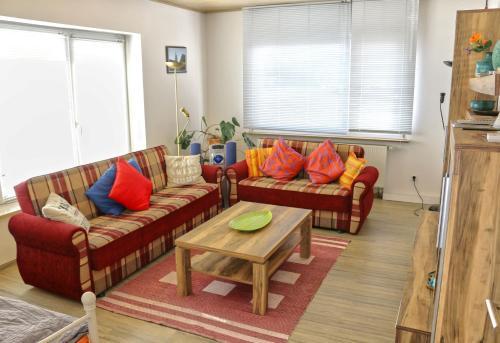 Ein Sitzbereich in der Unterkunft CMVA-Ferienwohnung Haus Gutleut