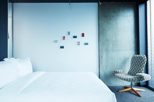 A bed or beds in a room at Alt Hotel Winnipeg