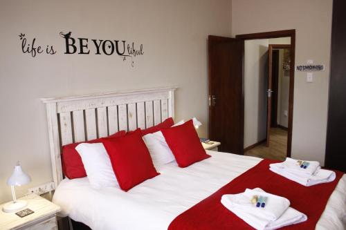 A bed or beds in a room at Villa Borghesi