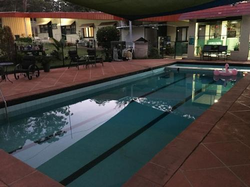 The swimming pool at or near Major Innes Motel