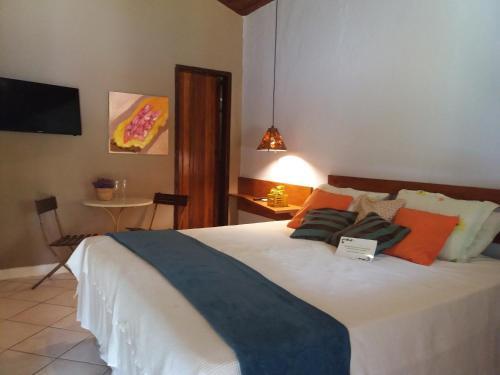 Cama ou camas em um quarto em Pousada Vila Mato Verde