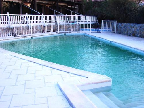 The swimming pool at or near Résidence Posidonie