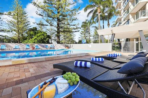 The swimming pool at or near Pacific Regis Beachfront Holiday Apartments