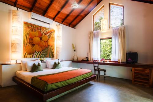 A bed or beds in a room at Sigiriana Resort by Thilanka