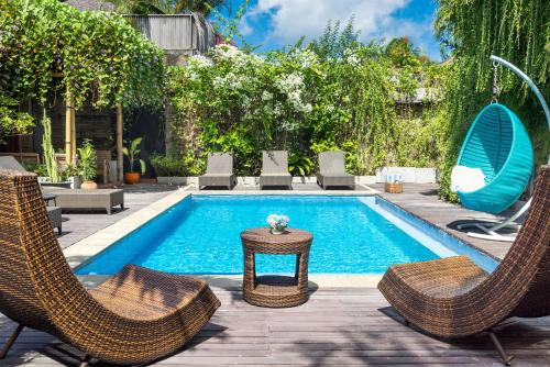 The swimming pool at or near Ocean Star Villa Four
