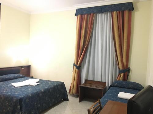 ホテル ポジターノにあるベッド