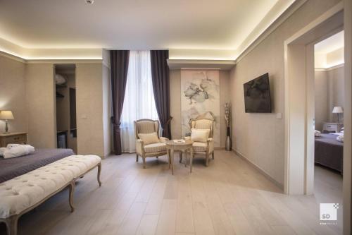 Hotel Cavour tesisinde bir oturma alanı