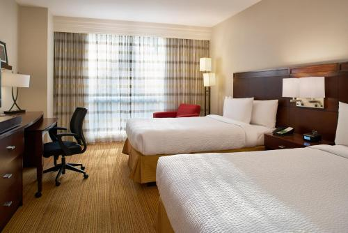 A bed or beds in a room at Courtyard by Marriott Mexico City Airport