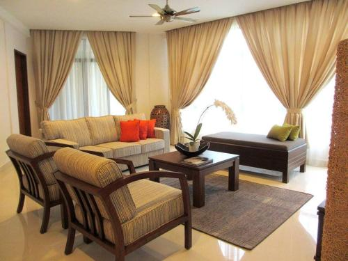A seating area at Samsuria Beach Resort & Residence