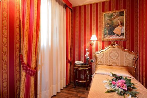 Cama ou camas em um quarto em Antico Panada