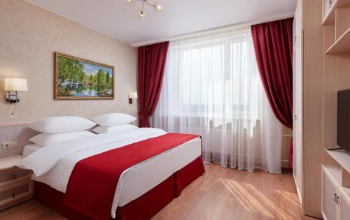 Кровать или кровати в номере Апарт-отель Ханой  - Москва